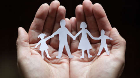 Paper chain family held in cupped hands